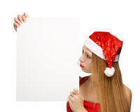 Young woman in santa claus hat with christmas card Stock Photography