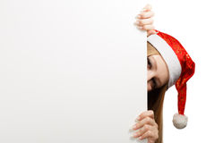 Young woman in santa claus hat with christmas card Stock Photo
