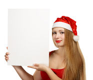 Young woman in santa claus hat with christmas card Stock Image