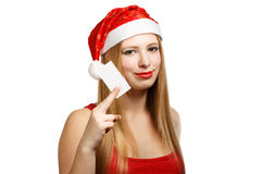 Young woman in santa claus hat with christmas card Stock Images