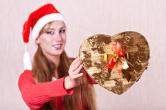 Young woman in Santa Claus hat with gift box Royalty Free Stock Photo