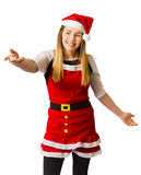 Young woman in santa costume pointing to ad space Stock Images