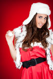 Young woman in santa costume posing Stock Images