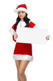 Young woman santa with empty board Royalty Free Stock Photo