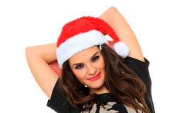 Young woman in santa hat Stock Image