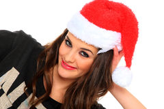 Young woman in santa hat Royalty Free Stock Photos