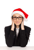 Young woman in santa hat Stock Images