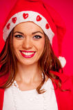 Young woman with Santa hat Stock Photos