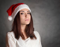 Young woman in Santa hat. Royalty Free Stock Image