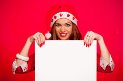 Young woman with Santa hat and blank paper Royalty Free Stock Photo