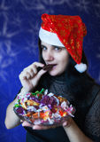 Young woman in santa hat with candy Royalty Free Stock Photo