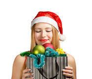 Young woman in santa hat with christmas attributes and gifts Stock Images