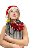 Young woman in santa hat with christmas attributes and gifts Royalty Free Stock Photography