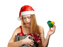 Young woman in santa hat with christmas attributes and little gi Royalty Free Stock Photography