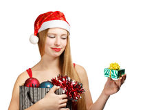 Young woman in santa hat with christmas attributes and little gi Stock Images
