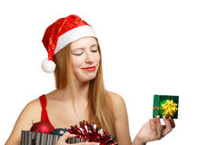 Young woman in santa hat with christmas attributes and little gi Royalty Free Stock Photo