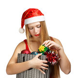 Young woman in santa hat with christmas attributes and little gi Royalty Free Stock Image