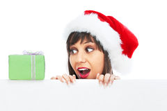 Young woman with santa hat and christmas gift Royalty Free Stock Photo