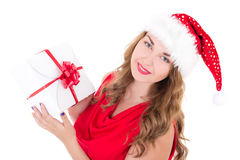Young woman in santa hat with christmas present isolated on whit Stock Photo