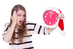 Young woman in santa hat with clock  Stock Photo