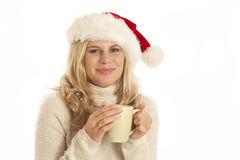 Young woman with Santa hat and coffee cup Stock Photos