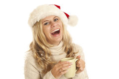 Young woman with Santa hat and coffee cup Royalty Free Stock Photos