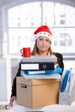 Young woman in santa hat dejected in office Stock Photos