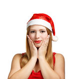 Young woman in santa hat with expressive gesture Stock Images