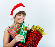 Young woman in santa hat with gift box Stock Photos