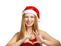 Young woman in santa hat with heart shape. Beautiful young woman in santa claus hat heart shape isolated on white background Stock Photo