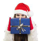 Young woman with Santa hat holding big blue gift box Stock Photo