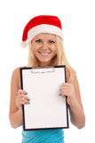 Young woman in santa hat holding blank board Royalty Free Stock Photography