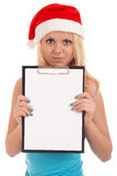 Young woman in santa hat holding blank board Royalty Free Stock Images