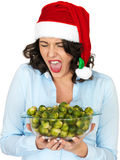 Young Woman in Santa Hat Holding a Bowl of Brussel Sprouts Stock Photos