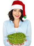 Young Woman in Santa Hat Holding a Bowl of Peas Stock Photos