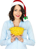 Young Woman in Santa Hat Holding a Bowl of Sweetcorn Royalty Free Stock Image