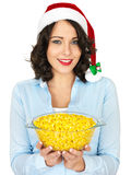 Young Woman in Santa Hat Holding a Bowl of Sweetcorn Stock Image