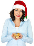 Young Woman in Santa Hat Holding Chocolate Money Stock Photography