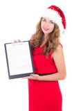 Young woman in santa hat holding clipboard with copyspace isolat Royalty Free Stock Photos