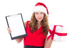 Young woman in santa hat holding clipboard with copyspace and pr Royalty Free Stock Image