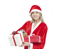 Young woman with Santa hat holding gift boxes Royalty Free Stock Photos