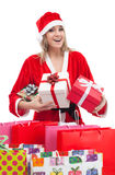 Young woman with Santa hat holding gift boxes and shopping bags Royalty Free Stock Photography