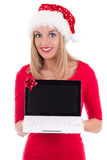 Young woman in santa hat holding notebook over white Stock Photography