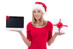 Young woman in santa hat holding notebook and present over white Royalty Free Stock Photography