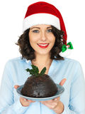 Young Woman in Santa Hat Holding a Traditional Christmas Pudding Royalty Free Stock Photo