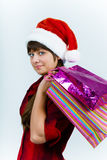 Young woman in santa hat with holiday shopping Stock Photo