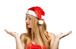 Young woman in santa hat with open hands Royalty Free Stock Image