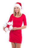 Young woman in santa hat posing with gift isolated on white back Stock Photography