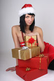 Young woman in santa hat with presents Stock Image