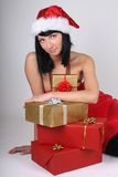 Young woman in santa hat with presents Royalty Free Stock Image